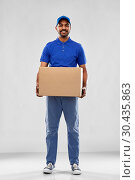 Купить «happy indian delivery man with parcel box in blue», фото № 30435863, снято 12 января 2019 г. (c) Syda Productions / Фотобанк Лори