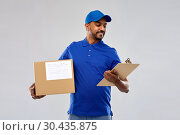 Купить «indian delivery man with parcel box and clipboard», фото № 30435875, снято 12 января 2019 г. (c) Syda Productions / Фотобанк Лори