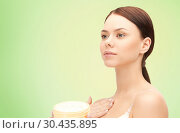 Купить «beautiful woman with moisturizing cream», фото № 30435895, снято 2 апреля 2011 г. (c) Syda Productions / Фотобанк Лори