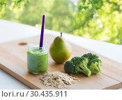 Купить «jar with puree or baby food on wooden board», фото № 30435911, снято 21 февраля 2017 г. (c) Syda Productions / Фотобанк Лори