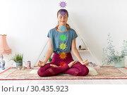Купить «woman meditating in lotus pose at yoga studio», фото № 30435923, снято 21 июня 2018 г. (c) Syda Productions / Фотобанк Лори