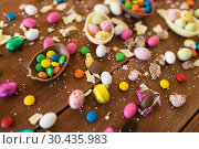 Купить «chocolate eggs and candy drops on wooden table», фото № 30435983, снято 15 марта 2018 г. (c) Syda Productions / Фотобанк Лори