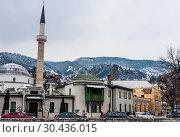 Купить «A minaret rises over buildings across the river from the Old Town neighborhood of Sarajevo, Bosnia Herzegovina», фото № 30436015, снято 26 февраля 2018 г. (c) Николай Коржов / Фотобанк Лори