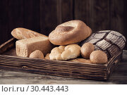 Купить «different types of bread on wooden background», фото № 30443443, снято 26 марта 2019 г. (c) Майя Крученкова / Фотобанк Лори