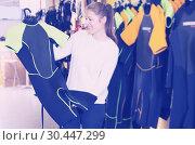 Купить «woman is satisfied of new costumes for diving», фото № 30447299, снято 25 января 2018 г. (c) Яков Филимонов / Фотобанк Лори