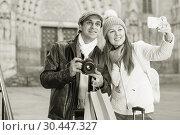 Купить «tourists taking selfie on mobile phone», фото № 30447327, снято 18 ноября 2017 г. (c) Яков Филимонов / Фотобанк Лори