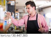 Купить «Joiner looking for necessary tools», фото № 30447383, снято 8 апреля 2017 г. (c) Яков Филимонов / Фотобанк Лори