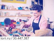 Купить «Joiner working in workshop», фото № 30447387, снято 8 апреля 2017 г. (c) Яков Филимонов / Фотобанк Лори