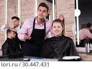 Купить «Female discussing haircut with hairdresser», фото № 30447431, снято 5 марта 2018 г. (c) Яков Филимонов / Фотобанк Лори