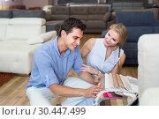 Купить «Family is choosing color of new sofa», фото № 30447499, снято 19 июня 2017 г. (c) Яков Филимонов / Фотобанк Лори