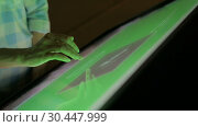 Woman using interactive touchscreen display at modern museum. Стоковое видео, видеограф Aleksey Popov / Фотобанк Лори
