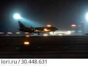 Купить «The plane takes off at night on a snowy runway.», фото № 30448631, снято 26 декабря 2018 г. (c) Андрей Радченко / Фотобанк Лори