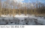 Купить «View from the window of a moving train», видеоролик № 30450139, снято 21 марта 2019 г. (c) Андрей Радченко / Фотобанк Лори