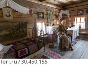 """Купить «The hut of a rural resident of the Siberian village of the 19th century of the second half. The interior of mid-20th century, period of the great patriotic war,Irkutsk region, Museum of wooden architecture """"Taltsy"""". Russia», фото № 30450155, снято 20 марта 2019 г. (c) Наталья Волкова / Фотобанк Лори"""
