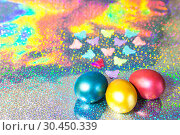 Купить «Easter background. Colored eggs of gold, pink, blue turquoise pearl color on a holographic rainbow background with a copy space», фото № 30450339, снято 31 марта 2019 г. (c) Светлана Евграфова / Фотобанк Лори