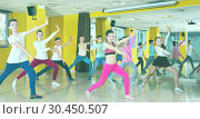 Купить «Children participating in dance class, following their teacher», фото № 30450507, снято 3 марта 2018 г. (c) Яков Филимонов / Фотобанк Лори