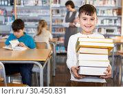Happy tween boy standing with books. Стоковое фото, фотограф Яков Филимонов / Фотобанк Лори