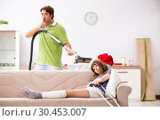 Купить «Husband helping leg injured wife in housework», фото № 30453007, снято 4 октября 2018 г. (c) Elnur / Фотобанк Лори