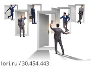 Купить «Businessman in uncertainty concept with many doors», фото № 30454443, снято 18 июня 2019 г. (c) Elnur / Фотобанк Лори