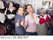 Купить «Women shopping uplifts and panties», фото № 30456007, снято 19 июля 2019 г. (c) Яков Филимонов / Фотобанк Лори