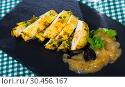 Купить «Turkey breast with caramelized onions and prunes served at plate», фото № 30456167, снято 25 мая 2019 г. (c) Яков Филимонов / Фотобанк Лори