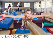 Купить «Girl training gymnastics at acrobatic hall», фото № 30474403, снято 17 января 2019 г. (c) Яков Филимонов / Фотобанк Лори