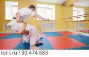 Athletic men engaged in martial art of aikido. A man shows his attacking skills. Стоковое видео, видеограф Константин Шишкин / Фотобанк Лори