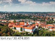 Купить «View from the top of Prague and the Strahov Monastery, Czech Republic», фото № 30474891, снято 7 сентября 2014 г. (c) Наталья Волкова / Фотобанк Лори