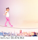 Купить «Beautiful black girl walking on the rope over city», фото № 30474963, снято 3 февраля 2019 г. (c) Сергей Новиков / Фотобанк Лори