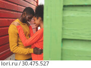 Купить «Romantic couple embracing each other in middle of beach hut», фото № 30475527, снято 14 ноября 2018 г. (c) Wavebreak Media / Фотобанк Лори