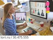 Купить «Female fashion designer using graphic tablet while working at desk», фото № 30475555, снято 18 ноября 2018 г. (c) Wavebreak Media / Фотобанк Лори