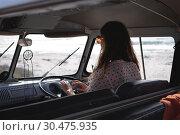 Купить «Beautiful woman driving a camper van at beach on a sunny day », фото № 30475935, снято 9 января 2019 г. (c) Wavebreak Media / Фотобанк Лори