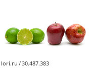 Купить «Lime and apples on white background», фото № 30487383, снято 19 мая 2014 г. (c) Ласточкин Евгений / Фотобанк Лори