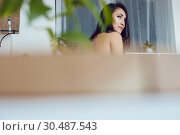 Купить «Attractive brunette woman in the kitchen.», фото № 30487543, снято 18 марта 2019 г. (c) Женя Канашкин / Фотобанк Лори