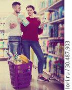 Купить «People buying detergents for house», фото № 30487903, снято 14 марта 2017 г. (c) Яков Филимонов / Фотобанк Лори