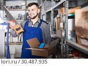 Купить «Master chooses the instruments for the repair», фото № 30487935, снято 15 марта 2017 г. (c) Яков Филимонов / Фотобанк Лори