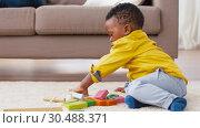 Купить «african american baby boy playing with toy blocks», видеоролик № 30488371, снято 24 марта 2019 г. (c) Syda Productions / Фотобанк Лори