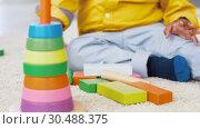 Купить «african american baby boy playing with toy blocks», видеоролик № 30488375, снято 24 марта 2019 г. (c) Syda Productions / Фотобанк Лори