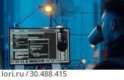 Купить «hacker using computer for cyber attack at night», видеоролик № 30488415, снято 30 марта 2019 г. (c) Syda Productions / Фотобанк Лори