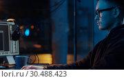 Купить «hacker using computer for cyber attack at night», видеоролик № 30488423, снято 30 марта 2019 г. (c) Syda Productions / Фотобанк Лори