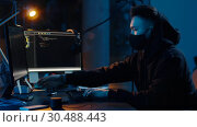 Купить «hacker in mask using computers for cyber attack», видеоролик № 30488443, снято 30 марта 2019 г. (c) Syda Productions / Фотобанк Лори