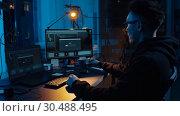 Купить «hacker using computer for cyber attack at night», видеоролик № 30488495, снято 30 марта 2019 г. (c) Syda Productions / Фотобанк Лори