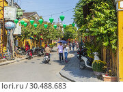 Купить «Street view of Duong Houng Dien in Hoi An old town, Hoi An, Quang Nam provence, Vietnam, Asia. Hoi An is a UNESCO designated heritage site. Hoi An is also known as Fai-Fo and Faifoo.», фото № 30488683, снято 6 февраля 2019 г. (c) age Fotostock / Фотобанк Лори