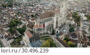 Купить «View of city landscape of Auxerre with Cathedral of Saint-Etienne on River Yonne on cloudy autumn day, Burgundy, France», видеоролик № 30496239, снято 24 октября 2018 г. (c) Яков Филимонов / Фотобанк Лори