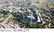 Купить «Aerial view of French fortified city of Carcassonne with medieval citadel in sunny autumn day», видеоролик № 30496275, снято 6 октября 2018 г. (c) Яков Филимонов / Фотобанк Лори