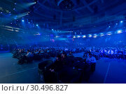 Купить «People attend business conference in large congress hall», фото № 30496827, снято 13 марта 2019 г. (c) Антон Гвоздиков / Фотобанк Лори