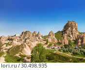 The view of the ancient city and fortress Uchisar, Cappadocia, Turkey (2015 год). Стоковое фото, фотограф Наталья Волкова / Фотобанк Лори