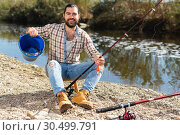 Купить «Lucky fisherman caught a trout fish», фото № 30499791, снято 15 марта 2019 г. (c) Яков Филимонов / Фотобанк Лори
