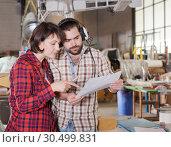 Купить «Couple checking drawings while modeling airplanes», фото № 30499831, снято 4 марта 2019 г. (c) Яков Филимонов / Фотобанк Лори