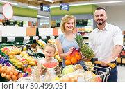 Купить «family shopping various fresh fruits in supermarket», фото № 30499951, снято 21 августа 2019 г. (c) Яков Филимонов / Фотобанк Лори
